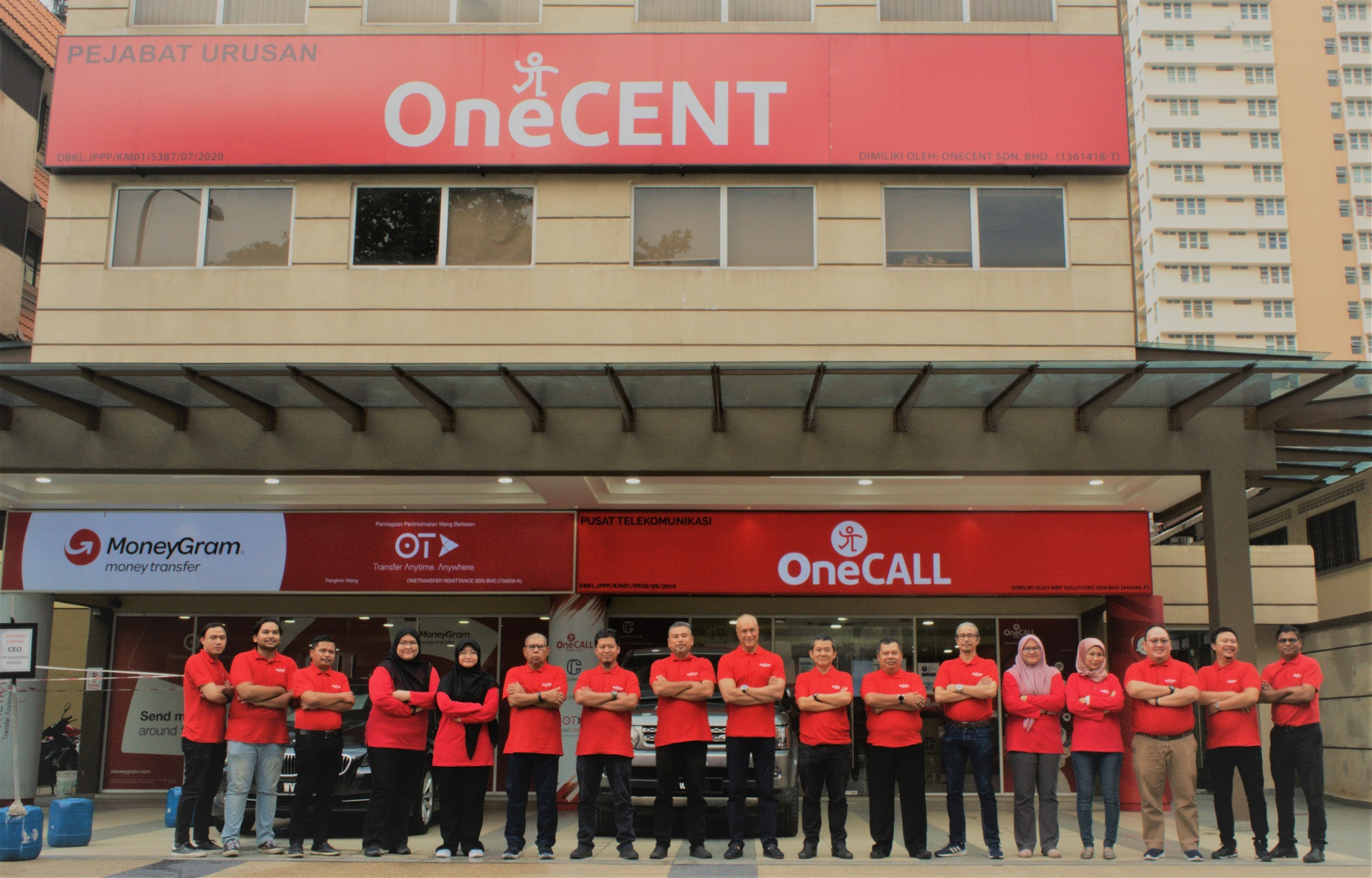 OneCENT Team Infront of Office Building